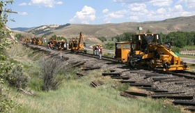 "A seemingly endless stream of equipment lines up east of my location just north of the tracks near Parshall, CO (five miles east of the ""Troublesome"" railroad siding).  I spent about an hour and a half here observing how an agressive tie replacement project works.  Half the ties (every other one) were to be replaced.  CRW 2622a"