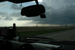 """DSC_3315a (Judd Spittler photo)We jumped back in the car and sped toward the tornado, hoping to get more shots.  As it turns out, the tornado quickly disappeared.We continued our drive, looking for more tornados, and trying to see if we could locate signs of the tornado's path.  We didn't see any more tornados, or locate any signs of the """"our"""" tornado's path.The tornado had probably been eight miles or so away when we took our first pictures.  We were probably five miles or less away when we took our closest photosWe returned """"home"""", fired up the barbeque and had supper.  It was a beautiful evening to be outside."""